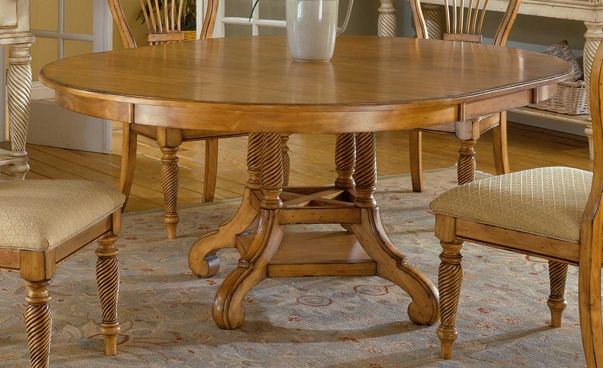Hillsdale wilshire round oval dining table antique pine for Antique dining room tables